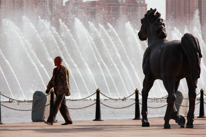 Man by horse and fountain
